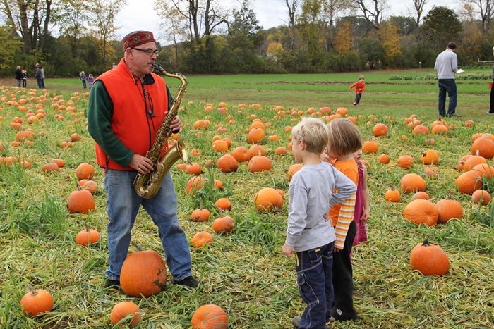 Saxiphonist in the pumpkin patch at Cedar Circle Farms annual pumpkin festival