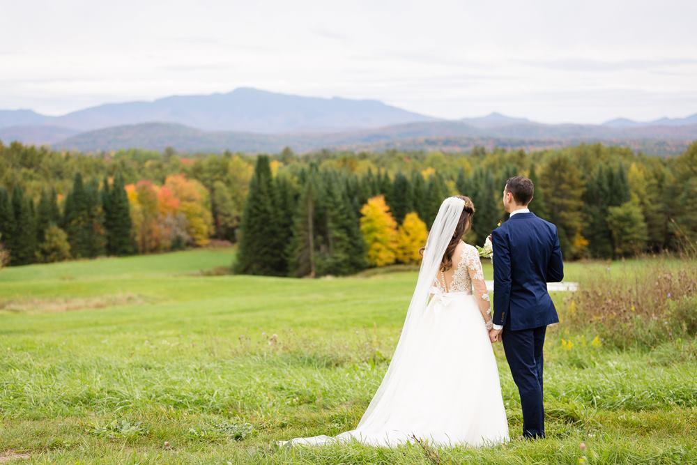 A wedding couple enjoying the view at The Inn at Grace Farm, Fairfax VT