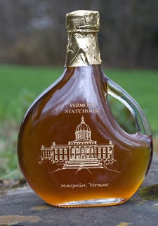 Sweet Retreat Sugarworks syrup bottle etched with the VT Statehouse