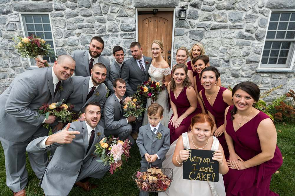 A wedding party in front of the Stone House at The Inn at Grace Farm in Fairfax, VT